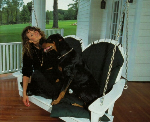 mariah carey with her doberman on swing